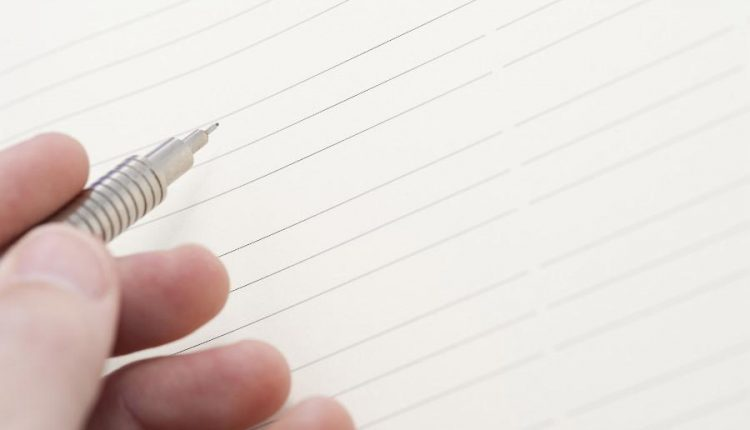blank writing paper and pencil